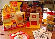 McDonald's Happy Meal Snack Maker (1993) I still have this in the garage.  It's absolutely disgusting at this point (18 years of wear and tear and musty garage air), but back in its day, this plastic machine was a thing of unrivaled excellence.  Way more fun than my Easy Bake Oven.