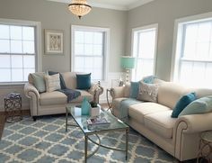 Aqua, teal, blues, and linen formal dining room. Brass and glass coffee table. Botanical Print. Featured on DIY Network show, Breakneck Builds