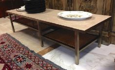 Absolutely Fabulous Mid-Century Modern Coffee Table. Travertine marble top on chrome frame with staggered cane magazine shelves. 60 x 18 x 14-3/4 in. tall. SOLD