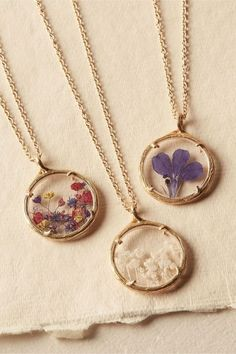 looooove this concept of putting old, dried flowers into necklaces