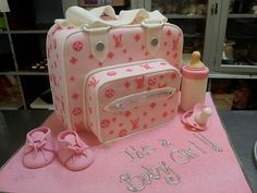 3D Louis Vuitton Diaper Bag shaped Wicked Chocolate cake in shades of pink by Charly's Bakery, via Flickr