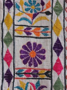 Vintage hand embroidered fabric with purple border from Gujarat, India. Detail.