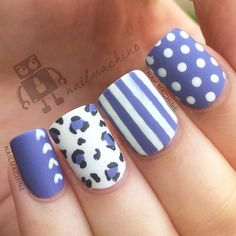 Pretty leopard nail art design with stripes, polka dots and hearts. The simplicity of this design is what makes it look outstanding. It highlights the simple design of each nail which in turn complements with one another.