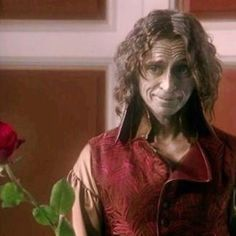 "Rumple: 'If you'll have it' (offering her the rose that is really Gaston) - 1.12 ""Skin Deep"""