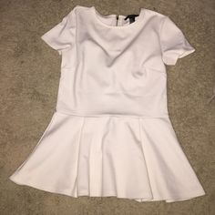 Cream Peplum Top almost White peplum top made of 72% polyester, 24% rayon, 4% spandex. Gold zipper. Forever 21 Tops Tees - Short Sleeve