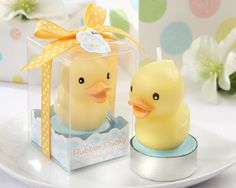 Adorable yellow rubber ducky baby shower candle favor, with smiling beak, sits on light blue pond in tin tea light candle cup. Too cute! Discount prices.