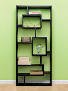 Eye-catching bookcase highlights pieces of 3D art.