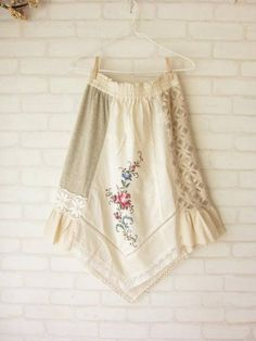 This skirt offers great apron idea --using a corner of an embroidered table cloth, patchwork, and lace = adorable!