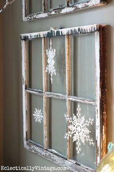 Vintage window with snowflakes - see the wintry white dining room at eclecticallyvinta...