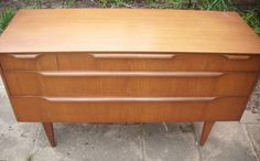 Retro Danish style wide chest of 5 teak drawers