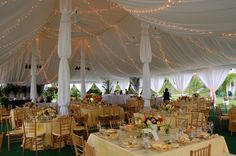 Wedding Tent - #tentedevent #tentliner #fabricswags #twinklelights #chiavarichairs #weddingdecor #MichiganWedding #OutdoorWedding #ColonialEvents