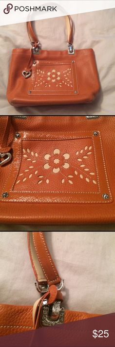 Brighton orange Pebbled leather floral cut out bag Being offered is an adorable very gently used orange Pebbled leather handbag with double patent leather straps. The front laser cut flower is a useable pocket and the interior also has a zippered pocket. The bag is clean inside and out and measures 12x8x4 smoke free home. Bag closes with a hidden magnet. I do bundle and take reasonable offers no trades Brighton Bags Shoulder Bags
