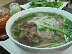 Pho is considered the most outstanding street in Vietnam, you can easily recognize it every corner of from the to the South. In each religion, has its own taste, but basically, Pho has 3 components including soup and beef. Vietnamese Pho, Vietnamese Cuisine, Vietnamese Recipes, Pho Restaurant, Vietnamese Restaurant, Rice Noodle Soups, Beef Noodle Soup, Pho Vietnam, Asian Soup
