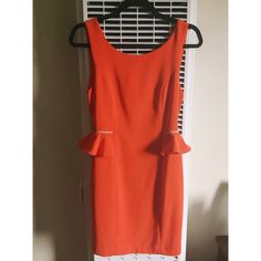 BLVD Peplum Dress with Gold Chain Detail at waist. Super chic BLVD brand peplum dress with gold detail at waist. Rich orange color. V shaped back with invisible zipper. Some of the invisible thread on the left side is loose as shown in 4th picture. Price reflects imperfection. Fits size 2/4. BLVD Dresses