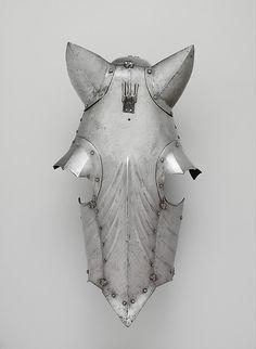Shaffron Armorer: Attributed to Romain des Ursins (Italian, Milan, recorded in Lyon 1493–95) Date: ca. 1480–95; ear guards, eye guards, and plume holder, 19th century restorations Culture: Franco-Italian Medium: Steel Dimensions: L. 24 7/8 (63.2 cm); W. 13 in. (33 cm); Wt. 4 lb. 4 oz. (1918 g)