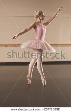 Beautiful ballerina dancing en pointe in the dance studio