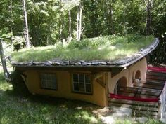 An earthen-roof home in the woods. Earth Sheltered Homes, Tiny House Blog, Living Roofs, Underground Homes, Survival Shelter, Cozy Cottage, Go Green, Cob Houses, Tree Houses