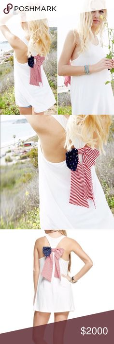 HERE!!  🇺🇸Americana Racerback Tunic Tank White tank with American Flag print bow on back.  Comfy and stretchy.  95% rayon, 5% spandex.  Made in the USA! 🇺🇸 Tops Tunics