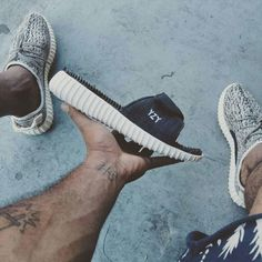 A sneaker customizer created a pair of adidas Yeezy Boost 350 slides inspired by a Photoshopped image. Take a closer look here. Slide Flip Flops, Converse, Vans, Sport Sandals, Yeezy Boost, Reebok, Adidas Sneakers, Leather, Shoes
