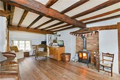 exposed beams and a log burner - how cosy