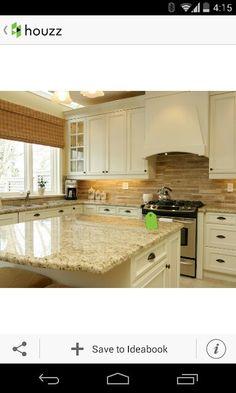 Giallo napoleon granite with 3d textured tile back splash