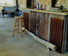 """I made this Western Saloon Pallet Backyard Bar using 4 1/2 pallets for the base. I added 2x12"""" boards to create the bar top."""