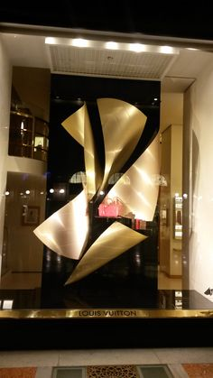 Louis Vuitton in Milan Central. Sheet metal twisted to form the interesting backdrop
