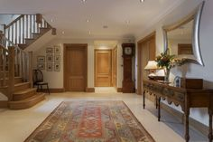 The persian rugs can make a welcoming space in the entry.