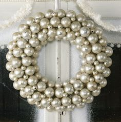 Dishfunctional Designs: Vintage Christmas Ornament Wreaths  I just might try making a wreath with spray painted pingpong balls.  Bright silver, brushed silver finish and maybe a white??  For the smaller rounds maybe some of those over sized pearl?