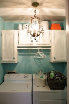 Remove cheap wire shelves and put up cabinets and curtain rod in the laundry room