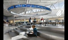 Intuitive wayfinding and on-brand environmental graphics get the job done at JetBlue's new JFK terminal. Environmental Graphic Design, Environmental Graphics, Rockwell Group, Tiered Seating, Lounge Design, Signage Design, Digital Signage, Digital Technology