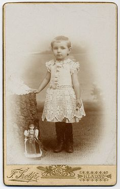 Little Girl With Doll, via Flickr.