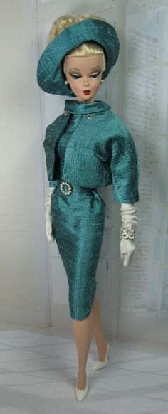 Barb - tres chic, I had an original when they first came out in 50's, Smithsonian magazine front covered Barbie with a showcase of 25 plus clothes, except for less than a handful I had owned everyone.  My mother sold my Barbie and case with all her clothes for $10, said I was too old to have the doll, I was 12!