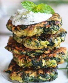 Zucchini, Feta, & Spinach Fritters with Garlic Tzatziki! Great for appetizers or a light snack, & a fantastic way to sneak in some veggies!