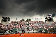 Dominic Thiem of Austria serves during the Men's Singles third round match against Alexander Zverev of Germany on day seven of the 2016 French Open at Roland Garros on May 28, 2016 in Paris, France.