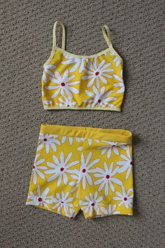 """""""Daises for you"""" and """"Golden rod.""""  Mini tank top with spaghetti straps trimmed in yellow elastic. Back of top is in solid """"golden rod.""""  Basic short with """"Golden rod"""" waistband."""