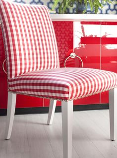 Upholstered parsons chair in gingham fabric + bright red lacquered dresser. #red