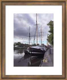 Marina Usmanskaya Framed Print featuring the photograph Quay Of Trave in Luebeck by Marina Usmanskaya The old part of the city Luebeck lies on a hill and is surrounded by the waters of Trave and Vakenica