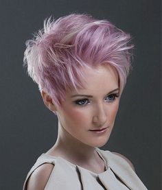 A Medium Pink straight coloured spikey white womens haircut hairstyle by Syran John Hairdressing