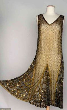 BEADED DANCE DRESS, 1920s. Beige net w/ allover geometric pattern in gold beads, gold sequin trim
