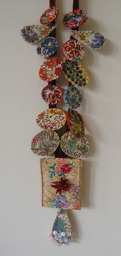 Kaori necklace | Flickr - Photo Sharing! Check out other necklaces on this site, small rounds of fabric with embroidery