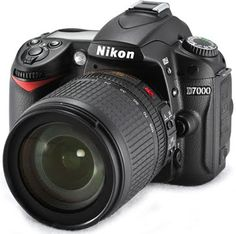 Nikon D7000 Body Only: $1200  What a nice gift this would make.  ;)