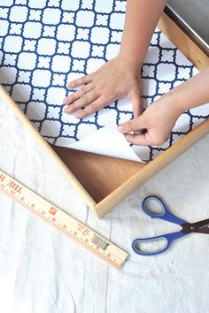 Lining the drawer of a dresser in a dresser makeover project