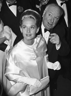 Tippi Hedren and Alfred Hitchcock attend the screening of The Birds at the Cannes Film Festival, 1963.
