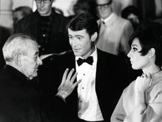 Audrey Hepburn, Peter O'Toole and William Wyler - outside The Ritz hotel in Paris, between takes during the filming of 'How To Steal a Million', 1966.