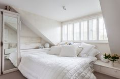 White minimal bedroom Jessica Zoob's Lewes Home . The small size of Jessica Zoob's Victorian house was no barrier to her creativity – she designed a space-smart home that's a tranquil haven