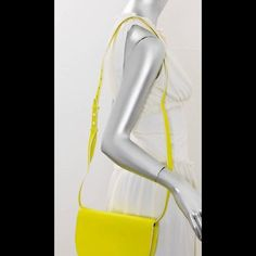 "NWOT Neon Kate Spade Saturday Yellow Crossbody Bag KATE SPADE Saturday Neon Yellow Leather Crossbody  use as clutch or waistpack  Material: Leather Color: Neon Yellow Hardware Color: White Condition: New without tags, wrapping still on strap. There is a slip pocket inside flap that closes with magnetic snap and one inside bag. Logo hang tag and embossed name inside flap. Windowpane fabric lining. Trim and hardware are white.  Got as gift have similar.    Measurements: Ht: 7""  D: 1.5""( up to…"