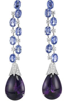 Сhopard amethyst and tanzanite dangle earrings, love the double baby prong on the amethysts~