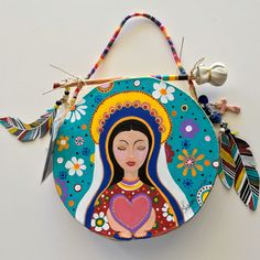 """""""OUR LADY"""" ~ $ 164  ~  10inch primitive drum & beater ~ designed & hand-painted by artist:  Sharon Gilbertson  (contact artist on website)  For clothing collection - follow link on website to Sharon's VIDA VOICES shop.  Thank you."""