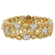 A Gold And Diamond Bracelet By Van Cleef & Arpels c.1964   From a unique collection of vintage more bracelets at https://www.1stdibs.com/jewelry/bracelets/more-bracelets/